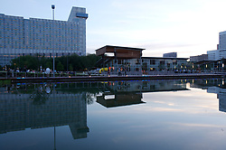 Stock photo of The Lake House restaurant and Hilton hotel from across the park's pond