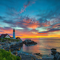Portland Head Lighthouse at Fort Williams Park is an iconic New England lighthouse located on Cape Elizabeth in Maine. The lighthouse towers over the swirling Atlantic Ocean and seacoast, marking the entrance to Casco Bay and Portland. Upon arrival the gates to the park were already open leaving me enough time to scout for an appropriate composition that allows to incorporate the anticipated magical morning show in the sky and some of the dramatic seascape of coastal Maine.<br /> <br /> Picturesque New England lighthouses photography images are available as museum quality photography prints, canvas prints, acrylic prints, wood prints or metal prints. Fine art prints may be framed and matted to the individual liking and decorating needs:<br /> <br /> https://juergen-roth.pixels.com/featured/maine-the-way-juergen-roth.html<br /> <br /> Good light and happy photo making!<br /> <br /> My best,<br /> <br /> Juergen<br /> Prints: http://www.rothgalleries.com<br /> Photo Blog: http://whereintheworldisjuergen.blogspot.com<br /> Instagram: https://www.instagram.com/rothgalleries<br /> Twitter: https://twitter.com/naturefineart<br /> Facebook: https://www.facebook.com/naturefineart