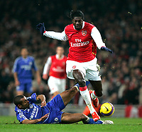 Photo: Tom Dulat/Sportsbeat Images.<br /> <br /> Arsenal v Chelsea. The FA Barclays Premiership. 16/12/2007.<br /> <br /> Chelsea's Ashley Cole trying to stop Arsenal's Emmanuel Adebayor running with the ball.