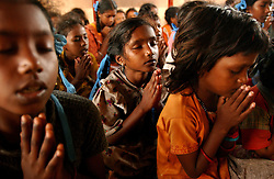 Orphans from the tsunami pray in a residential home in Nagapattinam district in Tamil Nadu, India August  31,2005.   Even though billions of dollars have been put towards the devastation, the recovery process is slow and the situation still grim for many of the world's poorest.  (Ami Vitale)
