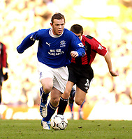 Photo. Jed Wee.<br /> Everton v Manchester City, FA Barclaycard Premiership, Goodison Park, Liverpool. 07/12/03.<br /> Everton's Wayne Rooney (L) leaves Man City's Joey Barton in his wake.