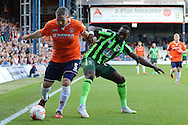 Ade Azeez of AFC Wimbledon battles with Stephen McNulty (Captain) during the Sky Bet League 2 match between Luton Town and AFC Wimbledon at Kenilworth Road, Luton, England on 26 September 2015. Photo by Stuart Butcher.