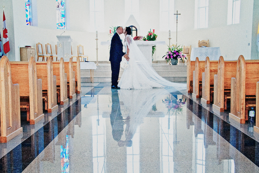 Bride and groom share a newlywed kiss