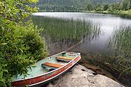 Rowboat on the shore of St. Mary Lake on Salt Spring Island, British Columbia, Canada
