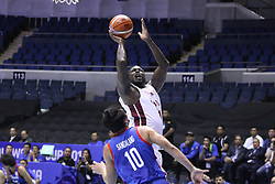 September 17, 2018 - Quezon City, NCR, Philippines - Mohd Yousuf Mohammed (White) of Qatar makes a lay-up over Ian Sanggalang (Blue) of the Philippines. (Credit Image: © Dennis Jerome S. Acosta/Pacific Press via ZUMA Wire)