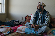Gulab looks out the window before evening prayers at his home in Fort Worth, Texas on May 6, 2016.