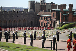 Members of the Royal Marines and the Foot Guards line the route of the procession at Windsor Castle, Berkshire, ahead of the funeral of the Duke of Edinburgh. Picture date: Saturday April 17, 2021.