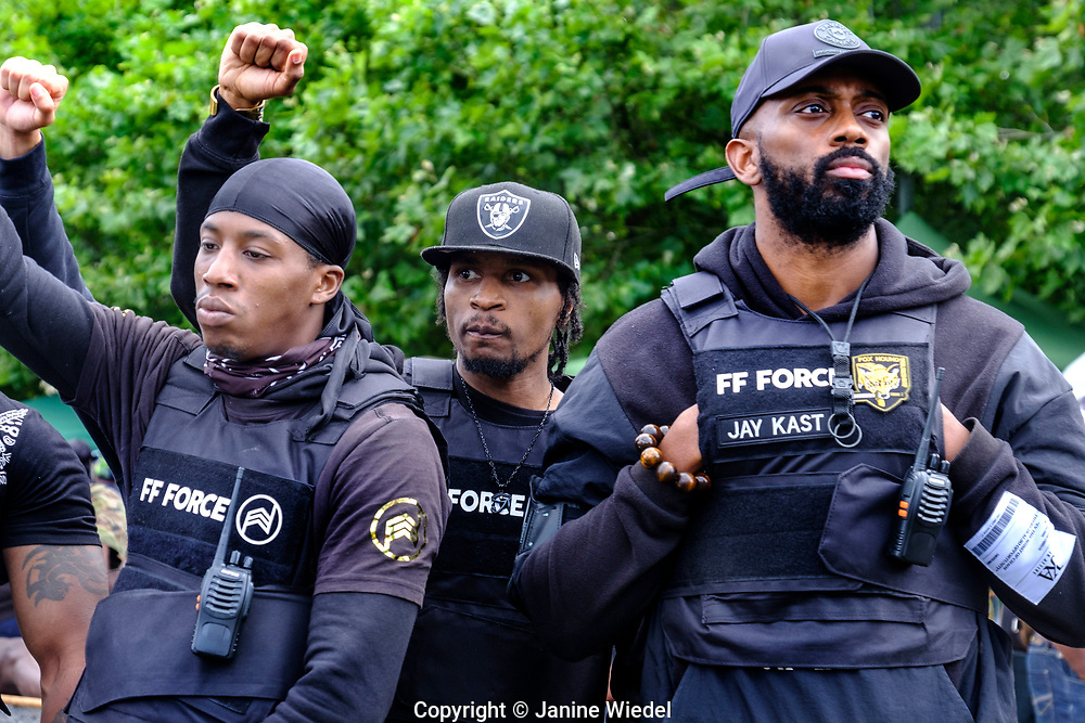 Black rights group FF Force ( Forever Family Force ) at  Reparations Rebellion event on Afrikan Emancipation Day in Windrush Square Brixton 2021.