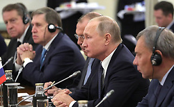 October 5, 2018 - New Delhi, India - October 5, 2018. - India, New Delhi. - Russian President Vladimir Putin during the Russia-India talks in the Hyderabad House. Right: Deputy Prime Minister Yury Borisov. From left: Russian Ambassador to India Nikolay Kudashev, Presidential Aide Yury Ushakov and Foreign Minister Sergey Lavrov. (Credit Image: © Russian Look via ZUMA Wire)
