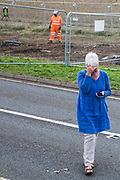 A local resident is overcome with emotion after watching the felling of a mature oak tree alongside the Fosse Way in connection with the HS2 high-speed rail link on 24th August 2020 in Offchurch, United Kingdom. The controversial HS2 infrastructure project is currently expected to cost £106bn and will destroy or significantly impact many irreplaceable natural habitats, including 108 ancient woodlands.