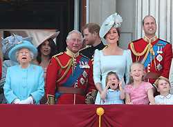 (left to right) Queen Elizabeth II, Duchess of Sussex, Prince of Wales, Duke of Sussex, Duchess of Cambridge holding Princess Charlotte, Duke of Cambridge holding Prince George and Savannah Phillips on the balcony of Buckingham Palace, in central London, following the Trooping the Colour ceremony at Horse Guards Parade as the Queen celebrates her official birthday.