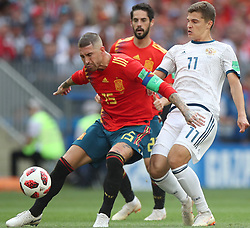 MOSCOW, July 1, 2018  Sergio Ramos (L) of Spain vies with Roman Zobnin (R) of Russia during the 2018 FIFA World Cup round of 16 match between Spain and Russia in Moscow, Russia, July 1, 2018. (Credit Image: © Wu Zhuang/Xinhua via ZUMA Wire)