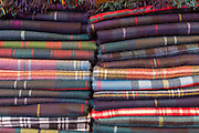 Traditional checks, plaid and highland clan tartan lambswool throws and textiles on display for sale at Lochcarron Weavers at Lochcarron in the Highlands of Scotland