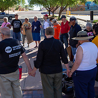 Joining hands in prayer the Poor People's Campaign marchers ended their rally at the McKinley County Courthouse Monday evening for their rally against uranium mining.