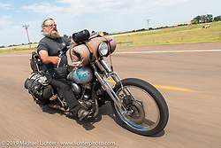 Panhead Billy rides his Harley-Davidson Panhead back to Sturgis after the annual Michael Lichter - Sugar Bear Ride hosted by Jay Allen with the Easyriders Saloon during the Sturgis Black Hills Motorcycle Rally. SD, USA. Sunday, August 3, 2014. Photography ©2014 Michael Lichter.
