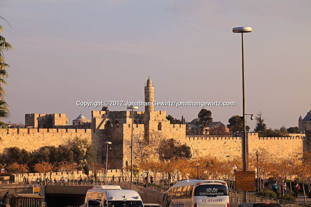 Traffic on Jerusalem's Jaffa Street passes along the walls of the Old City of Jerusalem. WATERMARKS WILL NOT APPEAR ON PRINTS OR LICENSED IMAGES.