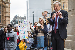 © Licensed to London News Pictures. 24/10/2017. London, UK. Lord Alfred Dubs (R) joins protesters opposite Parliament at a demonstration calling on the Home Office to offer asylum to child refugees trying to reach the UK from Calais. The demolition of the former 'Jungle' camp began one year ago, but many people still remain in Calais. Photo credit: Rob Pinney/LNP