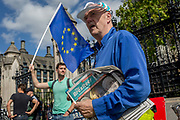 On the day that rebel Conservative Party rebels and opposition MPs attempt to pass a law designed to prevent a no-deal Brexit by the government of Prime Minister Boris Johnson, a Brexiteer hands out free copies of the The Brexiteer, the newspaper of Nigel Farages Brexit Party, outside Parliament, on 3rd September 2019, in Westminster, London, England.