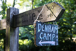A sign placed by activists from HS2 Rebellion in Colne Valley Park indicates the path to the Denham protection camp on 26 June 2020 in Denham, United Kingdom. Activists from HS2 Rebellion and Extinction Rebellion UK are taking part in a 'Rebel Trail' hike along the route of the HS2 high-speed rail link in protest against its environmental impact and to question the viability of the £100bn+ project.