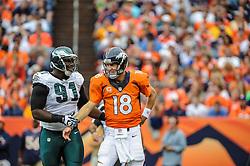 Sep 29, 2013; Denver, CO, USA; Philadelphia Eagles defensive end Fletcher Cox (91) and Denver Broncos quarterback Peyton Manning (18) during the game at Sports Authority Field at Mile High. Mandatory Credit: John Geliebter-Philadelphia Eagles