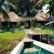 The entrance to the museum on the small island of Radio Peten Island, arriving by boat. Off the western side of the island of Flores is another much smaller island known simply as Radio Peten after the radio station that has broadcast from there since 1947. There are only a handful of buildings on the island, one of which is a small, one-room museum of Maya artifacts and various radio, telephone, and other artifacts. The only way to approach the island is by boat.