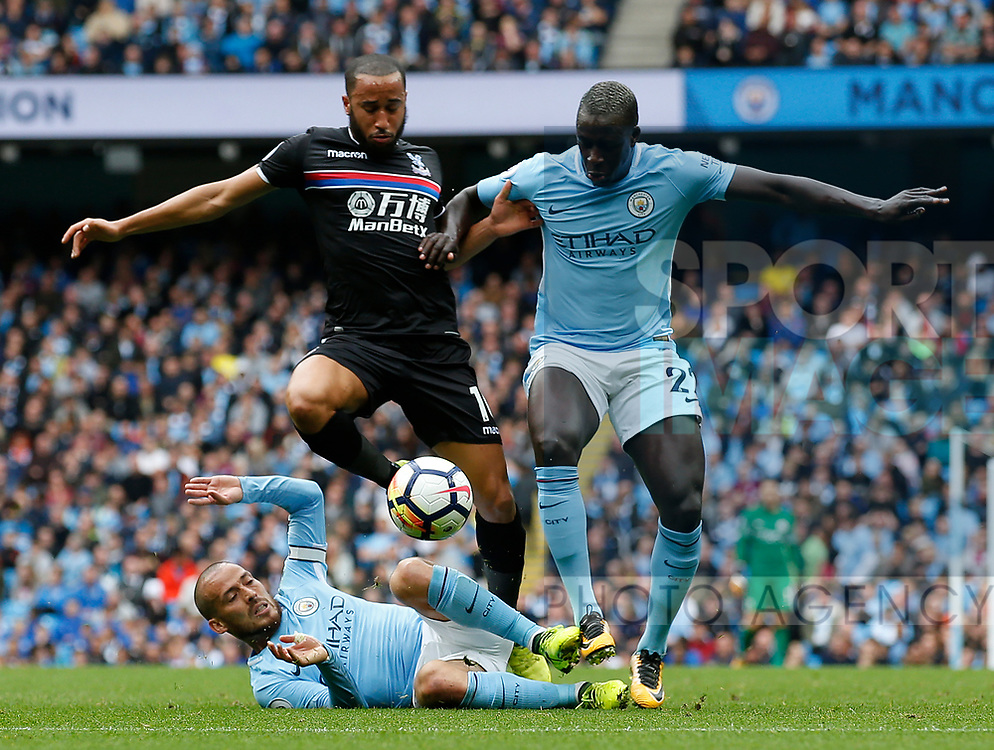 Andros Townsend of Crystal Palace and Benjamin Mendy of Manchester City go over the top of David Silva of Manchester City during the premier league match at the Etihad Stadium, Manchester. Picture date 22nd September 2017. Picture credit should read: Simon Bellis/Sportimage