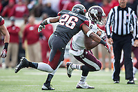 LITTLE ROCK, ARKANSAS - NOVEMBER 23:  Rohan Gaines #26 of the Arkansas Razorbacks tackles Malcolm Johnson #6 of the Mississippi State Bulldogs at War Memorial Stadium on November 23, 2013 in Little Rock, Arkansas.  The Bulldogs defeated the Razorbacks 24-17.  (Photo by Wesley Hitt/Getty Images) *** Local Caption *** Rohan Gaines; Malcolm Johnson