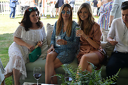 Left to right, Daniella Helayel, Zara Simon and Jessica Clarke at Cartier Queen's Cup Polo, Guard's Polo Club, Berkshire, England. 18 June 2017.<br /> Photo by Dominic O'Neill/SilverHub 0203 174 1069 sales@silverhubmedia.com