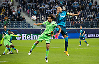 SAINT PETERSBURG, RUSSIA - NOVEMBER 04: Artem Dzyuba of Zenit St Petersburg contests Marco Parolo of SS Lazio for a header during the UEFA Champions League Group F stage match between Zenit St. Petersburg and SS Lazio at Gazprom Arena on November 4, 2020 in Saint Petersburg, Russia.(Photo by MB Media)