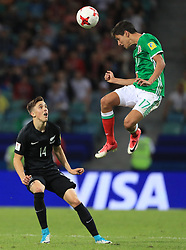 Mexico's Juergen Damm and New Zealand's Ryan Thomas (left) battle for the ball