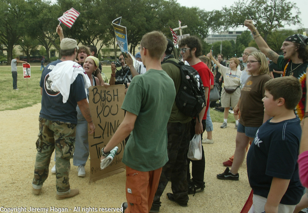An Iraq War Vet, left, spits in the face of anti-war activist Rose Lopez. The veteran had just attended a support our troops rally on the Washington Mall where anti-war activists had shown up.