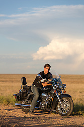 All American guy on a motorcycle taking a break to watch the sunset