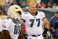Philadelphia Eagles center Mike McGlynn  #77 with Philadelphia Eagles mascot Swoop before the preseason game between the Cleveland Browns and the Philadelphia Eagles. The Eagles won 24-14 at Lincoln Financial Field in Philadelphia, Pennsylvania on Thursday August 25th 2011. (Photo By Brian Garfinkel)