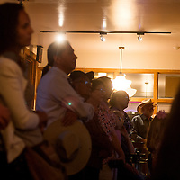 082313       Cable Hoover<br /> <br /> A crowd of visitors fils the room at the opening of the Old Train Music and Arts center in Gallup Friday.
