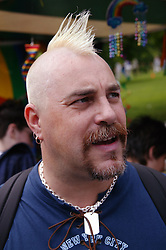 Portrait of a man with a Mohican hair cut at the Nottingham Pride Gay Lesbian festival; held at the Arboretum,