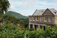 Tropical foliage surrounding the stone house in The Tower Garden, St. Paul's, Grenada, the Caribbean, West Indies