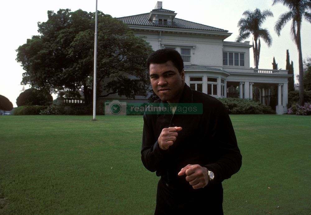 June 3, 2016 - File - MUHAMMAD ALI, the three time heavyweight boxing champion, has died at the age of 74. He had been fighting a respiratory illness. Pictured: Jan 01, 1980 - Los Angeles, California, USA - Boxing Legend MUHAMMAD ALI (born CASSIUS CLAY JR.) pictured in front of his Los Angeles home. (Credit Image: © Bernard Fallon/ZUMA Press)