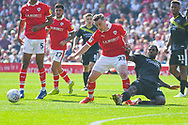 Anthony Grant of Shrewsbury Town (42) tackles Mike-Steven Bahre of Barnsley (21) during the EFL Sky Bet League 1 match between Barnsley and Shrewsbury Town at Oakwell, Barnsley, England on 19 April 2019.