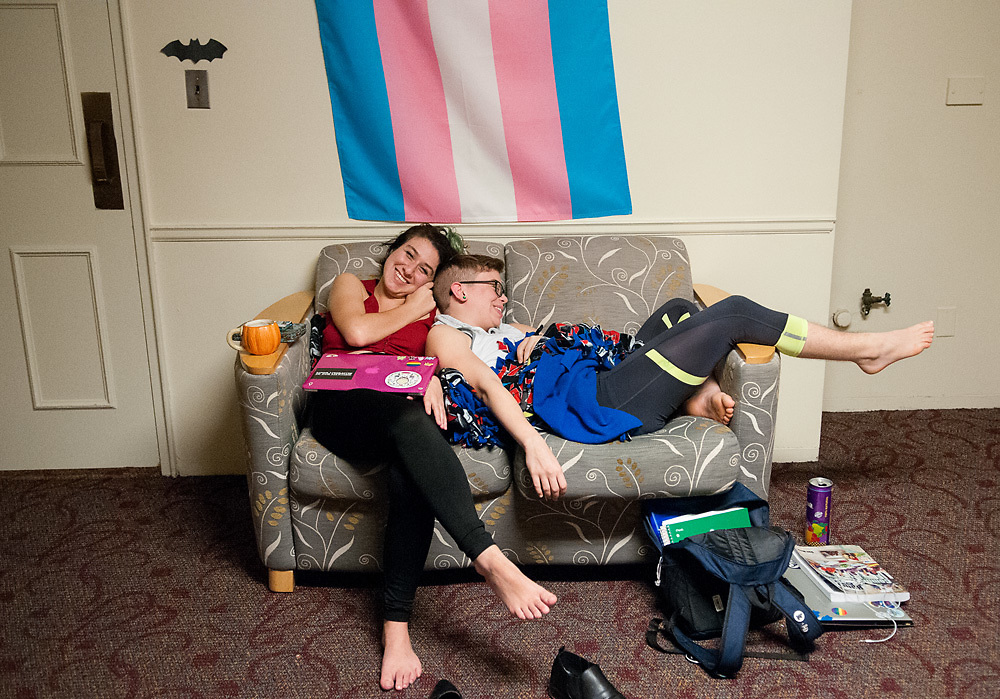 """Residents in the LGBT mod of Smith House, B Irwin (left) and Alex Petras(right), spend time together in their lounge on Thursday, October 20, 2016. Alex Petras, who identifies as a trans male and uses he/him pronouns, only considered attending schools with gender neutral housing options. """"Anywhere else on campus, I would have to live in the women's quarters,"""" he said. """"Which I wasn't comfortable with."""""""