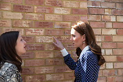 The Duchess of Cambridge looks at bricks dedicated to her grandmother Valerie Glassborow and aunt Mary Glassborow who both worked at Bletchley, during a visit to Bletchley Park to view a special D-Day exhibition in the newly restored Teleprinter Building.