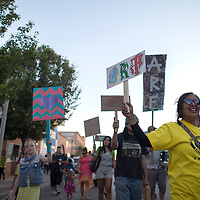 """061414      Cayla Nimmo<br /> <br /> Expressive Art Studios put on a """"March for Art"""" during Arts Crawl in downtown Gallup Saturday night."""
