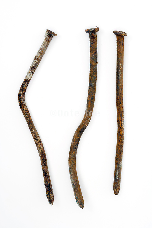 three old rusty nails