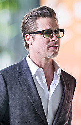 Brad Pitt, who accompanied Angelina Jolie and Foreign Secretary William Hague arrive at the End Sexual Violence in Conflict Summit. Image ©Licensed to i-Images Picture Agency. 12/06/2014. London, United Kingdom. Angelina Jolie. the Excel Centre. Picture by i-Images