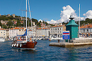 Harour entance with people relaxing and fishing off the harbour wall with a sailing boat. Piran , Slovenia Visit our PHOTO COLLECTIONS OF SLOVANIAN  HISTOIC PLACES for more photos to download or buy as wall art prints https://funkystock.photoshelter.com/gallery-collection/Pictures-Images-of-Slovenia-Photos-of-Slovenian-Historic-Landmark-Sites/C0000_BlKhcYWnT4Sites/C0000qxA2zGFjd_k