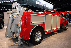 12 February 2015:   Ford F750 Super Duty in tow truck dress.<br /> <br /> First staged in 1901, the Chicago Auto Show is the largest auto show in North America and has been held more times than any other auto exposition on the continent. The 2015 show marks the 107th edition of the Chicago Auto Show. It has been  presented by the Chicago Automobile Trade Association (CATA) since 1935.  It is held at McCormick Place, Chicago Illinois