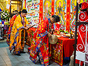 24 AUGUST 2018 - GEORGE TOWN, PENANG, MALAYSIA: Taoist priests perform a hungry ghost ritual in front of a home in George Town during Hungry Ghost Month. The Ghost Festival, also known as the Hungry Ghost Festival is a traditional Buddhist and Taoist festival held in Chinese communities throughout Asia. The Ghost Festival, also called Ghost Day, is on the 15th night of the seventh month (25 August in 2018). During Ghost Festival, the deceased are believed to visit the living. In many Chinese communities, there are Chinese operas and puppet shows and elaborate banquets are staged to appease the ghosts.      PHOTO BY JACK KURTZ
