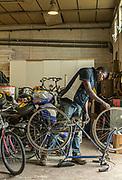 Italy, Capannori, cycle shop at the Daccapo warehouse, Razak