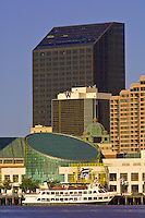The Audubon Aquarium of the Americas with the skyline of New Orleans behind; New Orleans, Louisiana, USA
