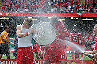 Community  Shield Millennium Stadium Cardiff  Liverpool v Chelsea (2-1)  13/08/2006<br />Peter Crouch   (Liverpool) scorer of winning goal with John Arne Riise and trophy  get sprayed by Bolo Zenden<br />Photo Robin Parker Fotosports International