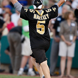 Apr 28, 2010; Metairie, LA, USA; Garrett Hartley (5) reacts after hitting a homerun during the Heath Evans Foundation charity softball game featuring teammates of the Super Bowl XLIV Champion New Orleans Saints at Zephyrs Field.  Mandatory Credit: Derick E. Hingle-US-PRESSWIRE.